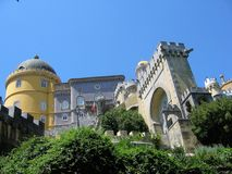 Detail of the castle of Sintra in top to a hill with a forest around. Portugal. Antique castle. Castle in top to a hill. Forest of trees. Perched castle. Travel royalty free stock photo