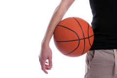 Detail of casual man holding a basketball ball. Isolated in white background royalty free stock photos