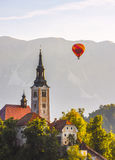 Detail of Catholic Church in Bled Lake, Slovenia with Hot Air Ba Royalty Free Stock Image