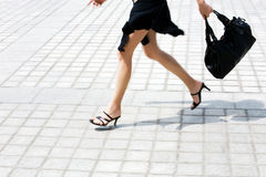 Detail caucasian woman legs running in the street Royalty Free Stock Photos