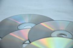 Detail of CD. Detail view of old compact discs on grey background Royalty Free Stock Photography