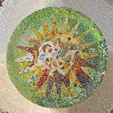 Detail of Ceiling. With mosaic green sun of Park Guell designed by Antonio Gaudi in Barcelona stock images