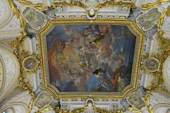 Detail of the ceiling painting and a tour of the Royal Palace. In Madrid stock photography