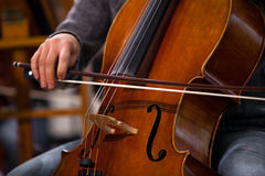 Detail of the cello in the hands of a musician Royalty Free Stock Photo