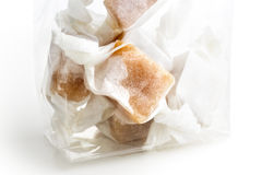 Detail of cellophane packet of wrapped caramel toffees. Royalty Free Stock Images