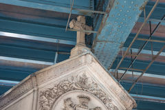 Detail of a cenotaph. Under the bridge that spans over the Montmartre cemetery Royalty Free Stock Photos