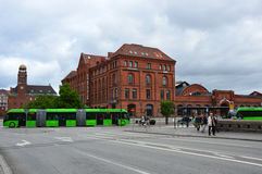 Detail of Central Station Malmo C, Central Railway Station with green articulated bus Ledbuss, Malmo, Sweden.  Royalty Free Stock Photos