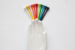 Detail of ceramic hand with golf balls and tees on the white woo Stock Images