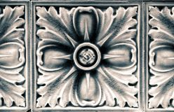 Ceramic Flower Tile. Detail of a ceramic tile featuring a flower stock images
