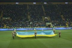 Detail of the ceremony before the football match. KHARKIV, UKRAINE - SEPTEMBER 2, 2011: Detail of the ceremony before the football match between national teams Stock Images