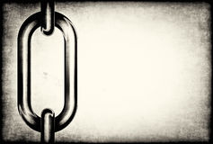 Detail of chain links on a grunge background Stock Photos