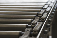 Detail of chain of roller conveyor Royalty Free Stock Photo