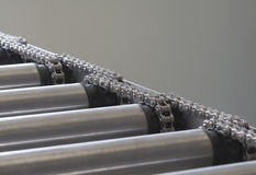 Detail of chain of roller conveyor - Shallow DOF Stock Image