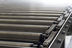 Detail of chain of roller conveyor - Shallow DOF Royalty Free Stock Image