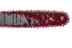 Detail of chainsaw with blood. Bloody chainsaw isolated on white royalty free stock photo