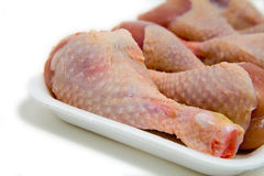 Detail of chicken leg on plastic plate Stock Photo