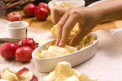 Detail of child hands making apple pie Stock Photo