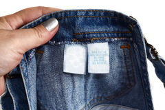 Detail of a children blue jeans label Stock Photo
