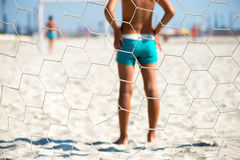 Detail of a children playing beach soccer. view behind the goal Royalty Free Stock Photography