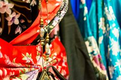 Detail of a chinese necklace on chinese dresses at the market Royalty Free Stock Photo
