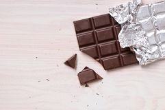 Detail of chocolate bar with silver wrapping top view Stock Image