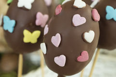 Detail of chocolate Easter eggs with heart and butterfly shaped Royalty Free Stock Photo