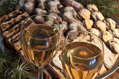 Detail of a christmas banquette. Wine with cakes Royalty Free Stock Photos