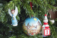 Detail of Christmas decoration hanging on pine tree.  Stock Photography