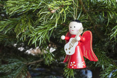 Detail of Christmas decoration hanging on pine tree.  Royalty Free Stock Images