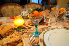 Detail of a Christmas/New`s year festive table at candle light. Christmas/ New`s Year festive home table showing traditional walnut and raisins cakes, seasons stock photo