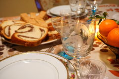 Detail of a Christmas/New`s year festive  table at candle light. Christmas/ New`s Year festive home table showing traditional walnut and raisins cakes,  seasons Stock Images