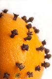 Detail of Christmas pomander. Detail of traditional Christmas pomander, an orange studded with cloves to put into hot mulled wine for flavour Stock Images