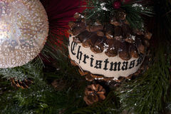 Detail Christmas tree decoration. Balls pine cones with message Stock Photography