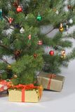 Detail of christmas tree with gifts. Detail of christmas pine  tree with gifts Stock Images
