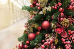 Detail Christmas tree with holiday red balls and lights with copy space on blurred bokeh background in interiors. Close up. Christmas tree with holiday silver Royalty Free Stock Photos