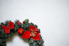 detail of a Christmas wreath on a white textured background, copy space stock image