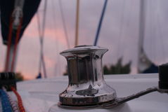 Detail of chromed bitt on yacht. With sunset sky Royalty Free Stock Images