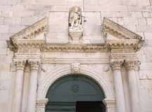 Detail of the church entrance door, Facade of old church in Omis Stock Images