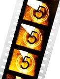 Cinema Countdown Film Strip. Three frames of old dusty universal cinema film leader with the number five stock photos