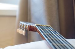 Detail of classic acoustic guitar with shallow DOF and blur Stock Photo