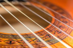 Detail of classic acoustic guitar with shallow DOF and blur Royalty Free Stock Photo