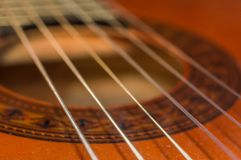 Detail of classic acoustic guitar with shallow DOF and blur Royalty Free Stock Photos