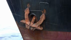 Detail of classic anchor in the port side of the bow. Old general cargo motor vessel with the anchor stored in the bow stock footage