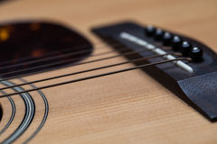Detail of classic guitar with shallow depth of field Royalty Free Stock Images