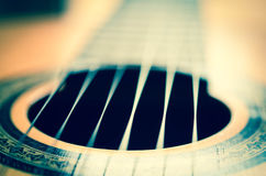 Detail of classic guitar with shallow depth of field Royalty Free Stock Photo