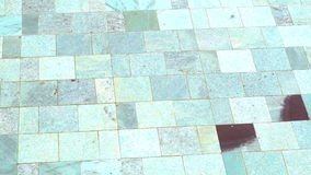 Detail of clear swimming pool water and natural stone tile floor. Detail of clear swimming pool with water and natural stone tile floor stock footage