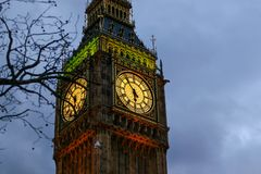Detail of clock on Big Ben in London. United Kingdom illuminated by lights in evening Royalty Free Stock Photos