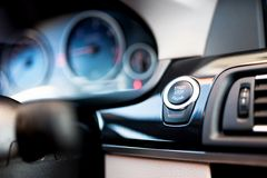 Detail close-up of car start and stop button. Modern car. Interior with minimalstic details Stock Photography
