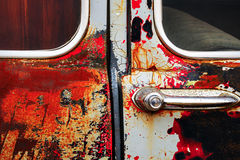 Detail close-up image of rusty old car door Royalty Free Stock Photo