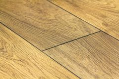 Detail close-up image of wooden parquet like tiles floor Stock Photos